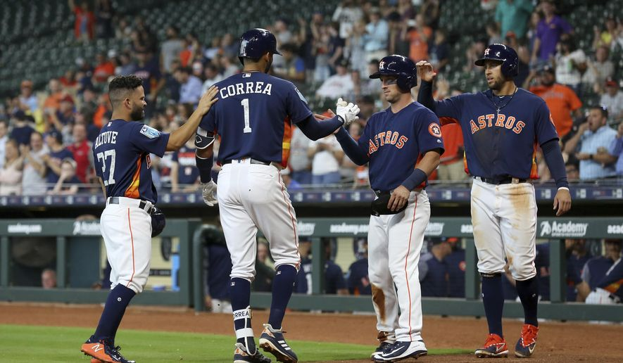Houston Astros' Carlos Correa (1) celebrates his grand slam against the Milwaukee Brewers with teammates during the first inning of a spring training baseball exhibition game at Minute Maid Park Tuesday, March 27, 2018, in Houston. (Godofredo A. Vasquez/Houston Chronicle via AP)