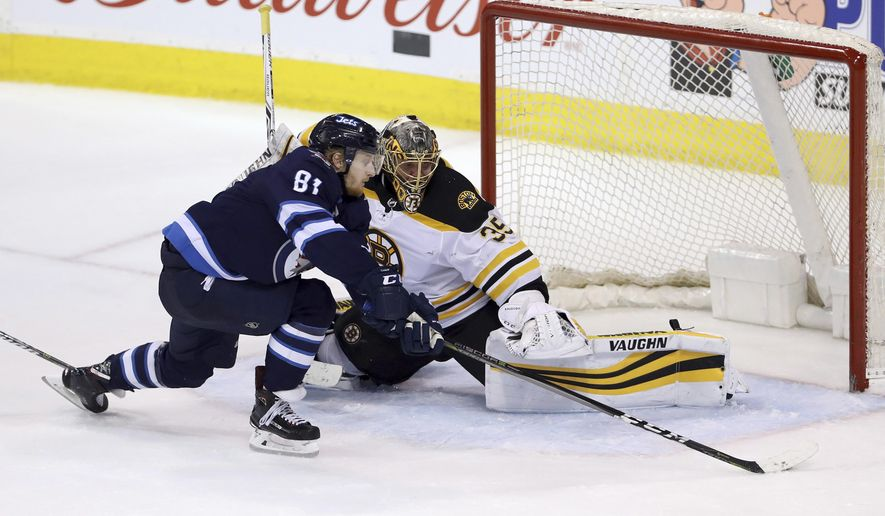 Winnipeg Jets' Kyle Connor (81) tries to get a shot on Boston Bruins goaltender Anton Khudobin (35) during overtime in an NHL hockey game Tuesday, March 27, 2018, in Winnipeg, Manitoba. (Trevor Hagan/The Canadian Press via AP)