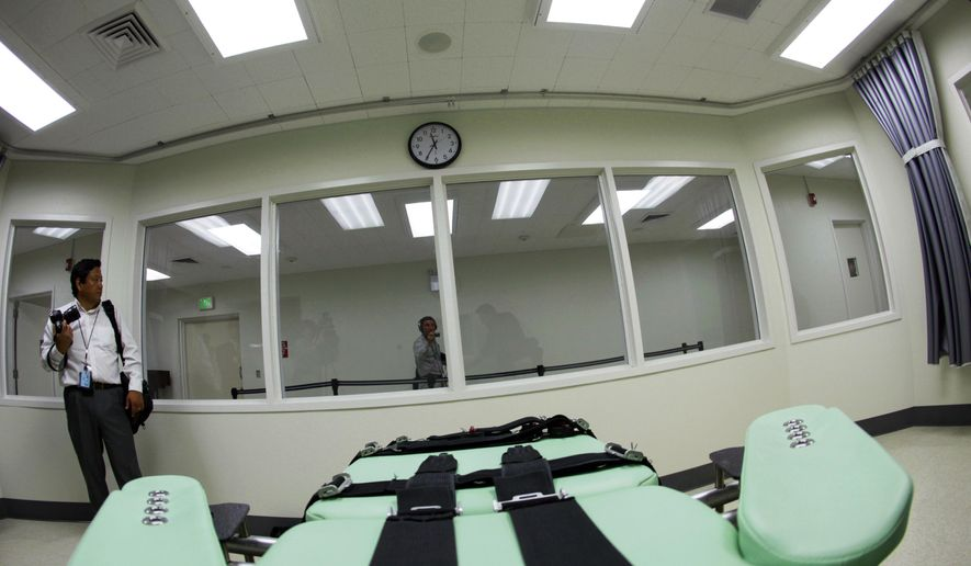 FILE - This Sept. 21, 2010 file photo shows the interior of the lethal injection facility at San Quentin State Prison in San Quentin, Calif. The battle over California's voter-backed effort to resume executions is beginning in earnest, with state officials and death penalty supporters moving to end court orders that have blocked executions since 2006. State officials and a former NFL player whose family was murdered are asking a Marin County judge on March 28, 2018, to lift his injunction, arguing that California now has the necessary regulations switching to a single lethal dose of powerful barbiturates to execute condemned inmates. (AP Photo/Eric Risberg, File)