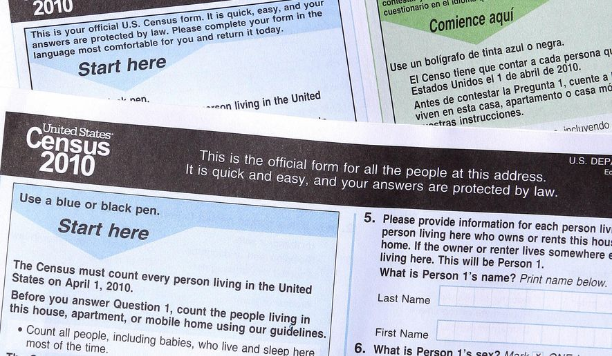 FILE - In this March 15, 2010, file photo, copies of the 2010 Census forms in Phoenix. The 2020 U.S. Census will add a question about citizenship status, a move that brought swift condemnation from Democrats who said it would intimidate immigrants and discourage them from participating.  (AP Photo/Ross D. Franklin, File)
