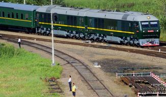 FILE - In this Aug. 30, 2010, file photo, a train believed to be carrying then North Korean leader Kim Jong Il moves past Dongjingcheng, Heilongjiang province, China. (Kyodo News via AP, File)