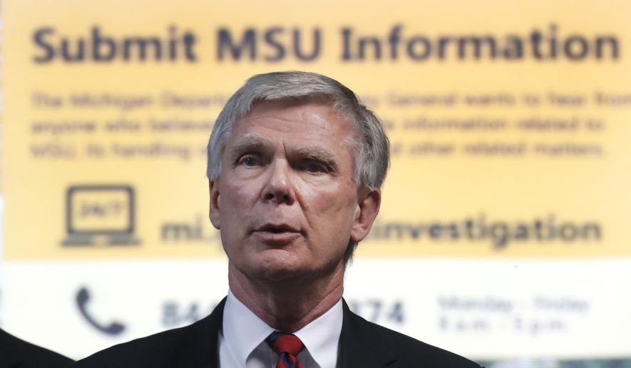 Special Prosecutor Bill Forsyth provides an update on his investigation into Michigan State University, Tuesday, March 27, 2018, in Lansing, Mich. William Strampel, a Michigan State University official who oversaw Larry Nassar, was arrested Monday amid an investigation into the handling of complaints against the former sport doctor, who is in prison for sexually assaulting patients under the guise of treatment. (AP Photo/Paul Sancya)