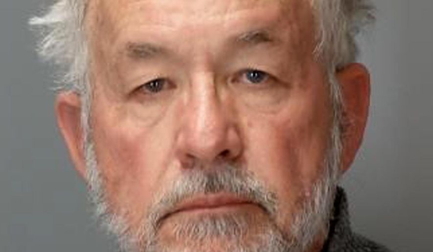 This booking photo provided by the Michigan Attorney General's Office on Tuesday, March 27, 2018, shows William Strampel, the former Dean of the MSU College of Osteopathic Medicine, who was arraigned Tuesday in District Court in East Lansing, Mich. Strampel, a Michigan State University official who oversaw Larry Nassar, was arrested Monday amid an investigation into the handling of complaints against the former sport doctor, who is in prison for sexually assaulting patients under the guise of treatment. (Michigan Attorney General's Office via AP)