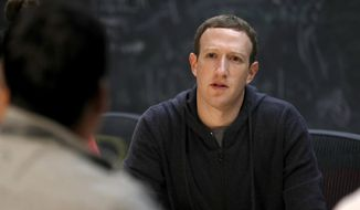 In this Nov. 9, 2017, file photo, Facebook CEO Mark Zuckerberg meets with a group of entrepreneurs and innovators during a round-table discussion at Cortex Innovation Community technology hub in St. Louis. (AP Photo/Jeff Roberson, File)