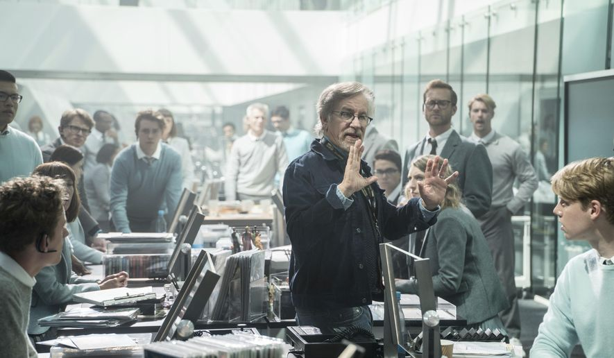 """This cover image released by Warner Bros. Pictures shows director Steven Spielberg on the set of """"Ready Player One."""" (Jaap Buitendijk/Warner Bros. Pictures via AP)"""