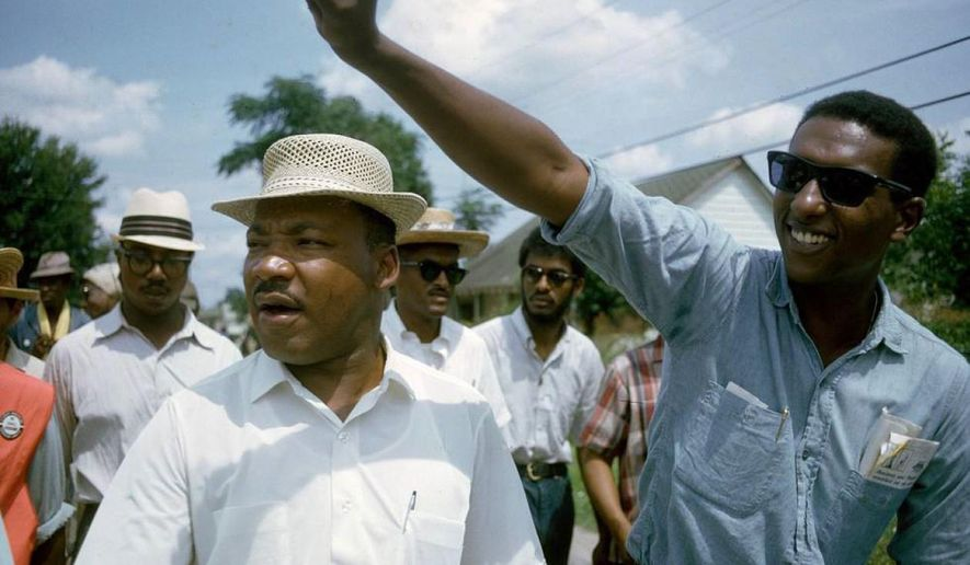 """This 1966 image released by HBO shows Dr. Martin Luther King, Jr., left, and Stokely Carmichael in Jackson, Miss., at the Meredith March, used in the documentary, """"King in the Wilderness."""" (Bob Fitch, Stanford University Libraries/HBO via AP)"""