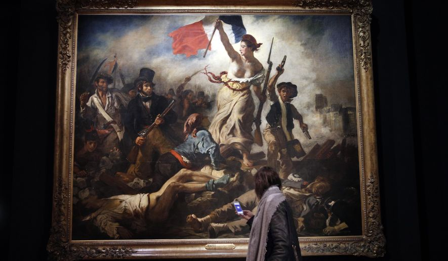 "A woman watches ""La liberte guidant le peuple"" by Eugene Delacroix at the Louvre museum, in Paris, Tuesday, March 27, 2018. The Louvre is seeking to reinterpret the work of Eugene Delacroix in a retrospective that goes beyond the brief years in which he painted his most recognizable masterpieces such as ""Liberty Leading the People"" that's graced postage stamps and bank notes in France as well as a Coldplay album cover. The exhibition runs from March 29 to July 23, 2018. (AP Photo/Christophe Ena)"