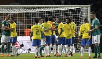 Germany, in green, and Brazilian players shake hands at the end of the international friendly soccer match between Germany and Brazil in Berlin, Germany, Tuesday, March 27, 2018. (AP Photo/Markus Schreiber)