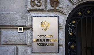 A sign reading 'Emabassy of the Russian Federation' displayed at entrance of the Russian embassy in Berlin, Germany, Tuesday, March 27, 2018. Germany will expelling four Russian diplomats in response to the recent nerve agent attack on a former Russian military intelligence officer and his daughter in Britain. (AP Photo/Markus Schreiber)