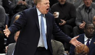 Minnesota Timberwolves head coach Tom Thibodeau react to a call as his team play against the Minnesota Timberwolves during the third quarter of an NBA basketball game on Monday, March 26, 2018, in Minneapolis. The Grizzlies won 101-93. (AP Photo/Hannah Foslien)