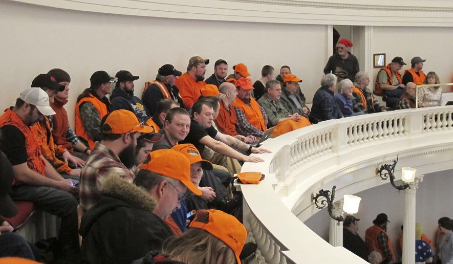"Gun control opponents wearing hunter orange pack the gallery in the Vermont House of Representatives on Tuesday March 27, 2018 in Montpelier, Vt. The House is set to debate Tuesday afternoon a measure that would raise the legal age for gun purchases, expand background checks and ban high-capacity magazines and rapid-fire devices known as ""bump stocks."" Opponents say the legislation is unconstitutional and won't enhance school safety. (AP Photo/Wilson Ring)"