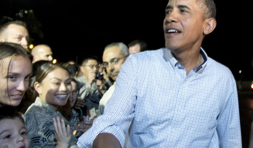 FILE--In this Jan. 4, 2014, file photo, President Barack Obama greets people on the tarmac before boarding Air Force One at Honolulu Joint Base Pearl Harbor-Hickam, in Honolulu as he travels back to Washington after his annual family vacation. A state Senate committee in Hawaii is calling for a statue of former President Barack Obama to be erected in the state where he was born. (AP Photo/Carolyn Kaster, file)
