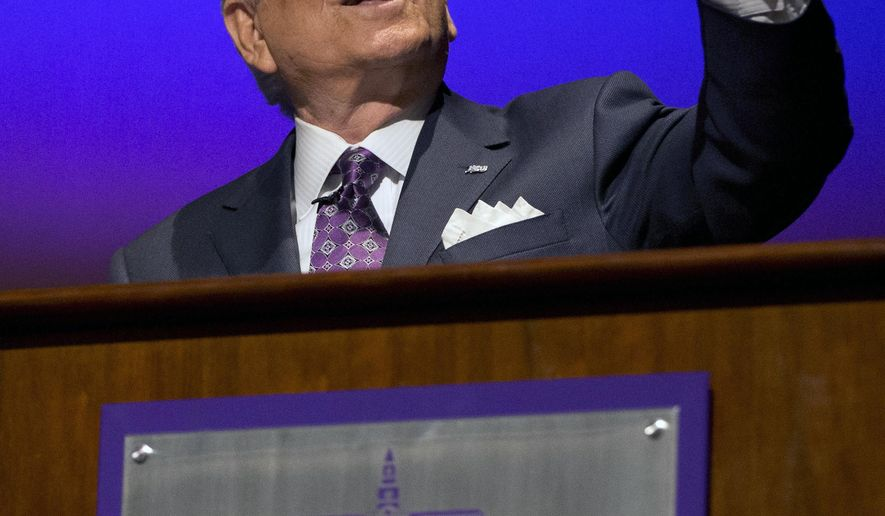 High Point University President Nido Qubein gestures while speaking at a press conference where Tubby Smith was introduced as the schools new NCAA college basketball head coach, in High Point, N.C., Tuesday, March 27, 2018. (Andrew Krech/News & Record via AP)
