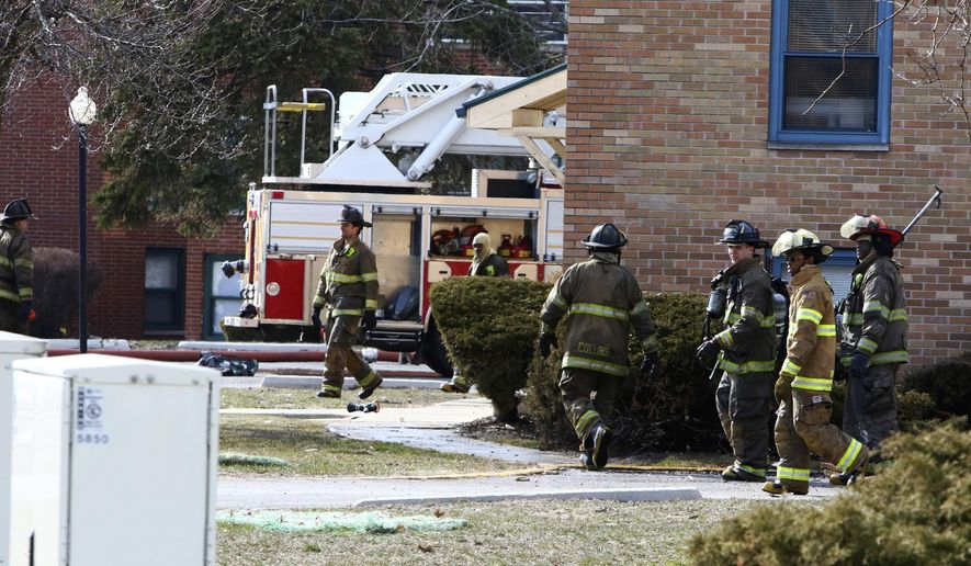 In this Sunday, March 25, 2018 photo, Gary fire and police crews respond to the scene of a deadly fire at the Lakeshore Dunes Apartments in Gary, Ind.  The cause is under investigation. (Kale Wilk/The Times via AP)