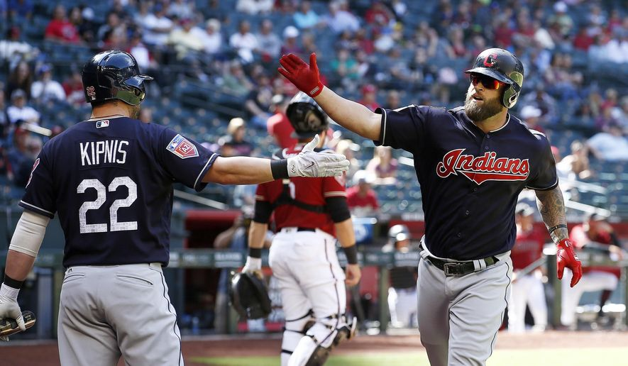 Cleveland Indians' Mike Napoli, right, celebrates his home run against the Arizona Diamondbacks with Jason Kipnis (22) during the sixth inning of a spring training baseball game Tuesday, March 27, 2018, in Phoenix. (AP Photo/Ross D. Franklin)