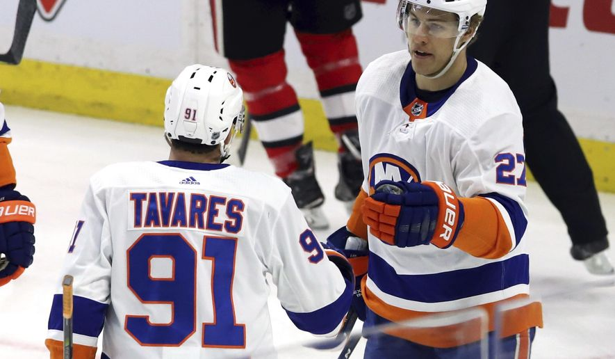 New York Islanders left wing Anders Lee (27) celebrates his goal against the Ottawa Senators with teammate John Tavares during first period NHL hockey in Ottawa, Tuesday, March 27, 2018. (Fred Chartrand/The Canadian Press via AP)