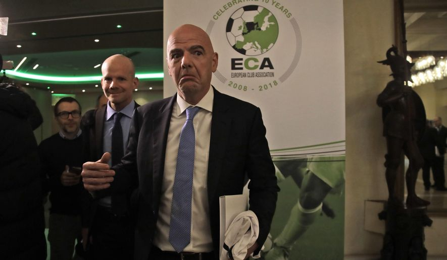 FIFA president Gianni Infantino leaves at the end of European Club Association's (ECA) 20th General Assembly, in the organization's 10-year anniversary in Rome, Tuesday, March 27, 2018. (AP Photo/Alessandra Tarantino)