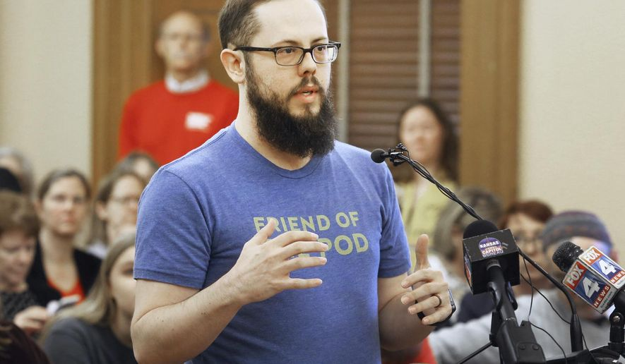 During a hearing in the House Insurance Committee Tuesday, March 27, 2018, in Topeka, Kan., Nick Diegel, an Overland Park resident and parent of a Blue Valley district student, spoke in opposition to a bill that would help Kansas teachers carry concealed guns in their classrooms. Diegel also referenced Rep. Willie Dove, a Bonner Springs Republican who last year removed a handgun from an ankle holder and accidentally left it on the floor of a House committee meeting room. (Thad Allton /The Topeka Capital-Journal via AP)