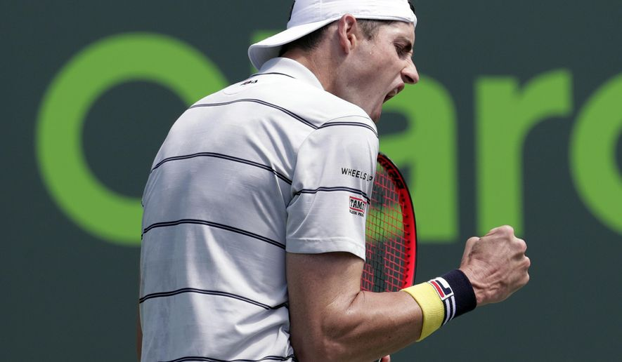 John Isner reacts after winning a point against Marin Cilic, of Croatia, during the Miami Open tennis tournament, Tuesday, March 27, 2018, in Key Biscayne, Fla. Isner won 7-6 (0), 6-3. (AP Photo/Lynne Sladky)