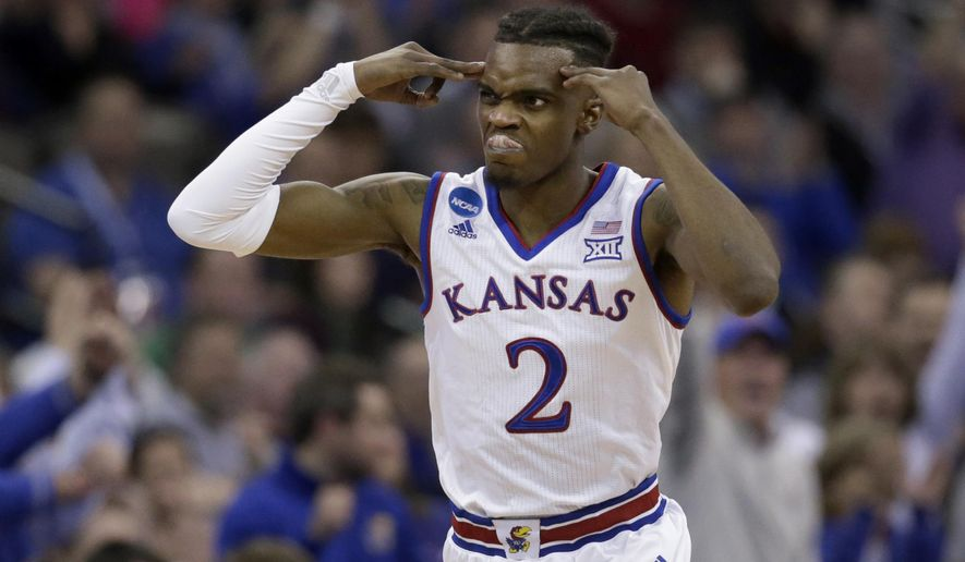Kansas' Lagerald Vick celebrates after making a 3-point basket during the second half of a regional final game against Duke in the NCAA men's college basketball tournament Sunday, March 25, 2018, in Omaha, Neb. (AP Photo/Nati Harnik)