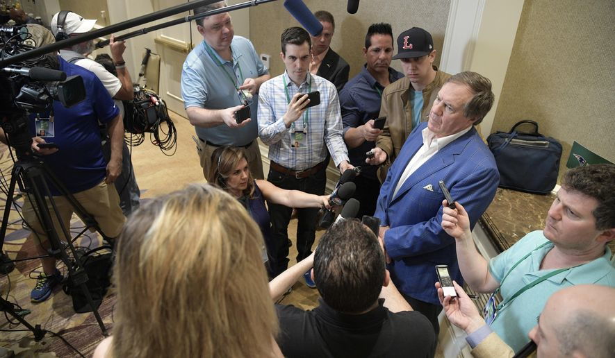 New England Patriots head football coach Bill Belichick, right, answers a question from a reporter at the coaches breakfast during the NFL owners meetings, Tuesday, March 27, 2018 in Orlando, Fla. (Phelan M. Ebenhack/AP Images for NFL)