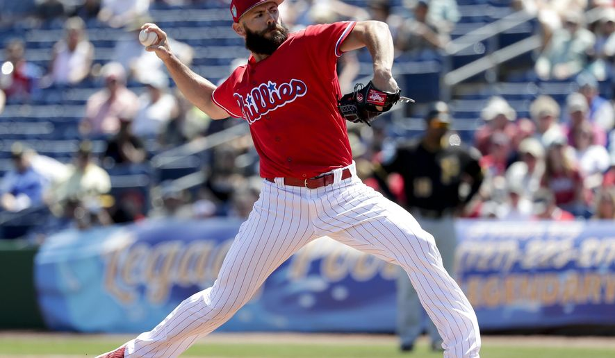 Philadelphia Phillies starting pitcher Jake Arrieta throws in the first inning of a spring baseball exhibition game against the Pittsburgh Pirates, Tuesday, March 27, 2018, in Clearwater, Fla. (AP Photo/John Raoux)