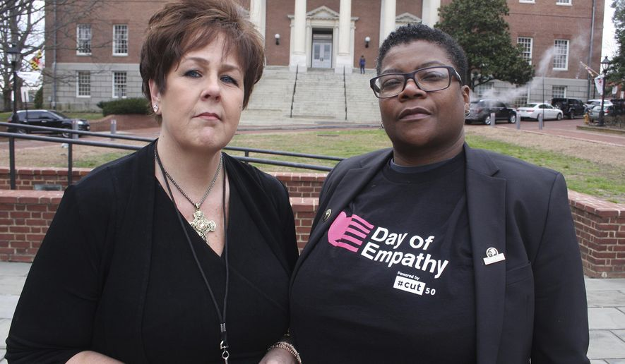 In this March 3, 2018 photo, Kimberly Haven, left, and Monica Cooper, two advocates for reforms in correctional facilities, pose for a photo in front of the Maryland State House in Annapolis, Md. Both Haven and Cooper, who are former inmates, testified in favor of a measure to ensure women have free access to menstrual products on request while in correctional facilities. Growing recognition about the lack of access to basic feminine hygiene products that can occur in correctional facilities has created a wave of measures in state legislatures. (AP Photo/Brian Witte)