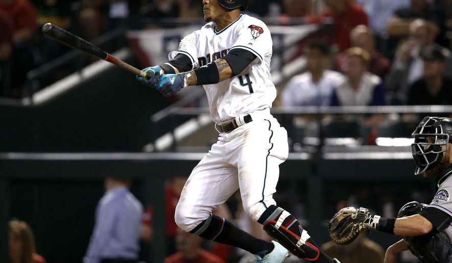 FILE - In this Wednesday, Oct. 4, 2017, file photo, Arizona Diamondbacks' Ketel Marte follows through on a triple against the Colorado Rockies during the fourth inning of the National League wild-card playoff baseball game, in Phoenix. On Monday, March 26, 2018, a person familiar with the deal says the Arizona Diamondbacks and infielder Marte have agreed to a $24 million, five-year contract. (AP Photo/Ross D. Franklin, File)