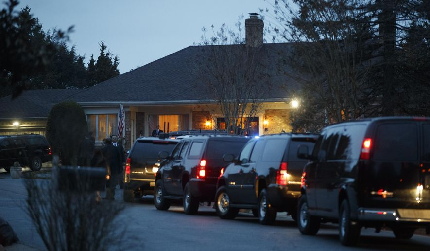 President Donald Trump's motorcade is parked in front of a private residence where the president is having dinner in McLean, Va., Tuesday, March 27, 2018. (AP Photo/Carolyn Kaster)