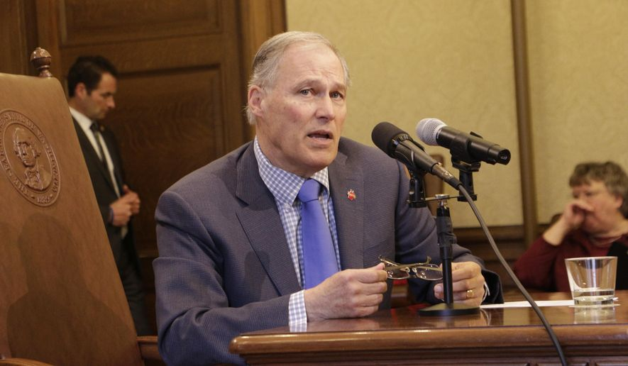 Gov. Jay Inslee speaks to reporters after signing a bill that alters the contracting structure of home health care workers, on Tuesday, March 27, 2018, in Olympia, Wash. Supporters of the measure says it streamlines management services of health care workers, but opponents who had asked Inslee to veto it argued it was meant to let a powerful union skirt a court ruling that pertained to union membership. (AP Photo/Rachel La Corte)