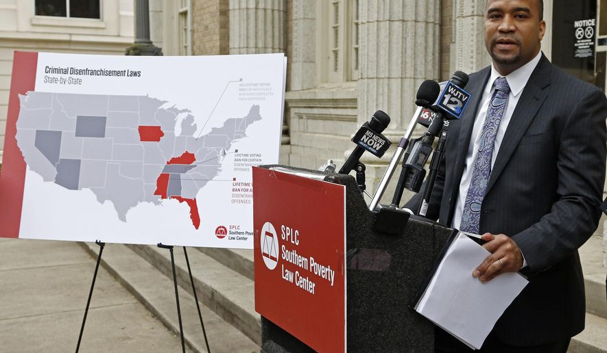 """Jody Owens, of the Southern Poverty Law Center, says Mississippi's system is """"harsh, punitive and unforgiving"""" and disproportionately hurts African-Americans, during a Tuesday, March 27, 2018, news conference in Jackson, Miss., where the center announced their new federal lawsuit challenging the limited way Mississippi restores voting rights to ex-convicts who complete their sentences. (AP Photo/Rogelio V. Solis)"""
