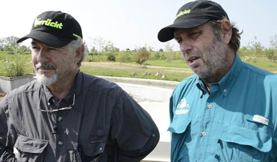In this July 2014 image from video, the Verruckt water slide designers, John Schooley, left, and Schlitterbahn co-owner Jeffrey Henry, speak about the challenges of opening the 17-story tall attraction prior to it's operation in Kansas City, Kan. The Kansas attorney general's office says Schlitterbahn Waterparks and Resorts co-owner Jeffrey Henry and ride designer John Schooley are charged with reckless second-degree murder in the indictment unsealed Tuesday March 27, 2018. The charges stem from the 2016 death of Caleb Schwab who was decapitated in 2016 when his ride went airborne at the water park in Kansas City. (Monty Davis /The Kansas City Star via AP)