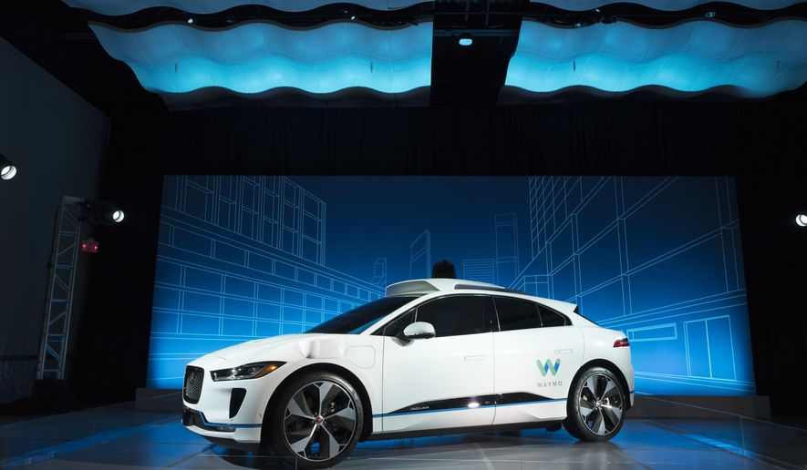 The Jaguar I-Pace vehicle is introduced Tuesday, March 27, 2018, in New York. Self-driving car pioneer Waymo will buy up to 20,000 of the electric vehicles from Jaguar Land Rover to help realize its vision for a robotic ride-hailing service. The commitment announced Tuesday marks another step in Waymo's evolution from a secret project started in Google nine years ago to a spin-off that's gearing up for an audacious attempt to reshape the transportation business. (AP Photo/Mark Lennihan)