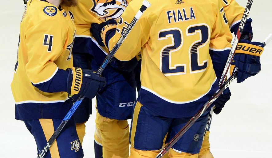 Nashville Predators defenseman Roman Josi (59), of Switzerland, celebrates with teammates after scoring a goal against the Minnesota Wild during the first period of an NHL hockey game Tuesday, March 27, 2018, in Nashville, Tenn. (AP Photo/Mark Zaleski)