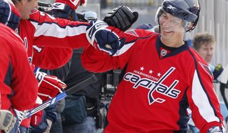 Washington Capitals alumnus Peter Bondra (right) celebrates with teammates after scoring against the Pittsburgh Penguins alumni team during an exhibition NHL hockey game on an outdoor rink at Heinz Field in Pittsburgh, Friday, Dec. 31, 2010. The game ended tied at 5-5. (AP Photo/Gene J. Puskar) **FILE**