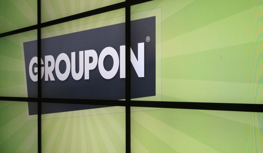 FILE - In this Sept. 22, 2012 file photo, the Groupon logo is displayed inside the online coupon company's offices, in Chicago. Groupon Inc., reports quarterly financial earnings Wednesday, Feb. 8, 2012, after the market close. (AP Photo/Charles Rex Arbogast, File)
