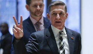 FILE- In this Nov. 17, 2016, file photo, retired Lt. Gen Michael Flynn gestures as he arrives with his son Michael G. Flynn, left, at Trump Tower in New York. Flynn was fired by one American commander-in-chief for insubordination, Now he may removed by another. Flynn resigned as President Donald Trump's national security adviser Monday, Feb. 13, 2017. (AP Photo/Carolyn Kaster, File)