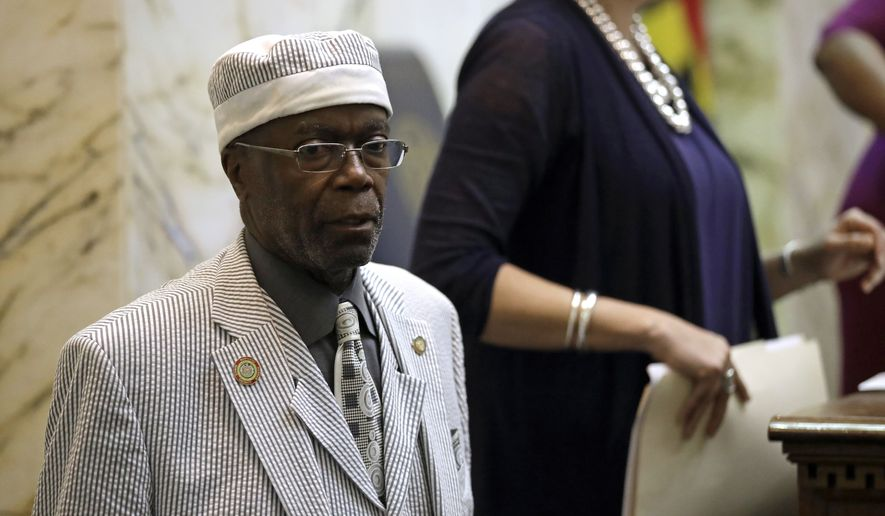 """Sen. Nathaniel Oaks, D-Baltimore City, stands in the Maryland House of Delegates chamber on the final day of the Maryland legislative session in Annapolis, Md., Monday, April 10, 2017. Federal prosecutors alleged Friday that Oaks accepted illegal payments in exchange for using his position to facilitate business deals, using the word """"lollipop"""" as code for every $1,000 he expected to collect. He pleaded not guilty Friday. (AP Photo/Patrick Semansky)"""