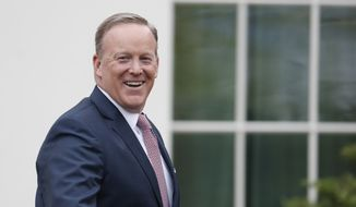 Outgoing White House press secretary Sean Spicer smiles as he departs the White House, Friday, July 21, 2017, in Washington. (AP Photo/Alex Brandon) ** FILE **