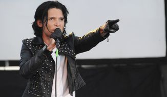 FILE - In this May 25, 2013, file photo, Corey Feldman performs in Los Angeles. Feldman was charged with possession of marijuana on Oct.  21, 2017, in Mangham, Louisiana, after being pulled over for speeding.  Feldman said the marijuana wasn't his, but was a medicinal drug for a member of his touring crew. Feldman is on tour with his band, The Angels. (Photo by Katy Winn/Invision/AP, File)