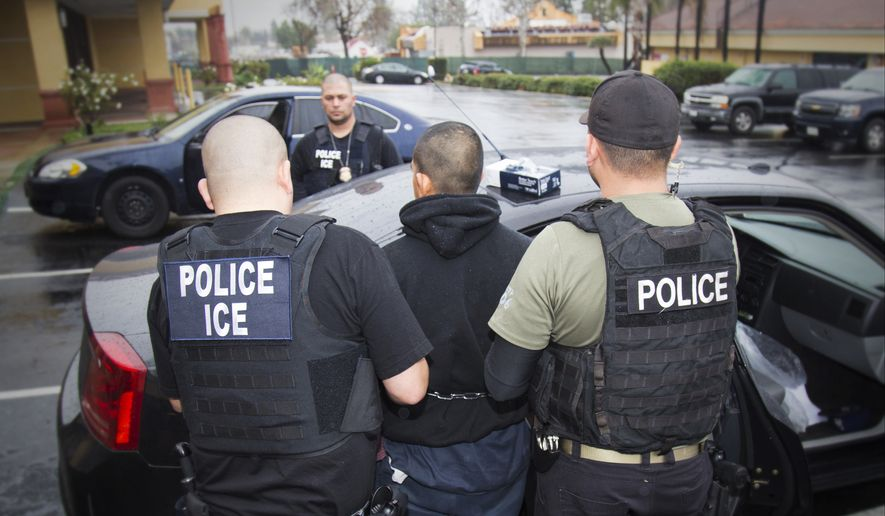 In this Feb. 7, 2017, photo released by U.S. Immigration and Customs Enforcement, foreign nationals are arrested during a targeted enforcement operation conducted by U.S. Immigration and Customs Enforcement (ICE) aimed at immigration fugitives, re-entrants and at-large criminal aliens in Los Angeles. (Charles Reed/U.S. Immigration and Customs Enforcement via AP, File)