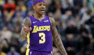 FILE - In this Monday, March 19, 2018, file photo, Los Angeles Lakers' Isaiah Thomas argues a call during the first half of an NBA basketball game against the Indiana Pacers in Indianapolis. Thomas will have season-ending arthroscopic surgery on his right hip, the team announced Wednesday, March 28, 2018. Thomas averaged 15.6 points and 5.0 assists in 17 games with the Lakers, who acquired him from Cleveland in February. (AP Photo/Darron Cummings, File)