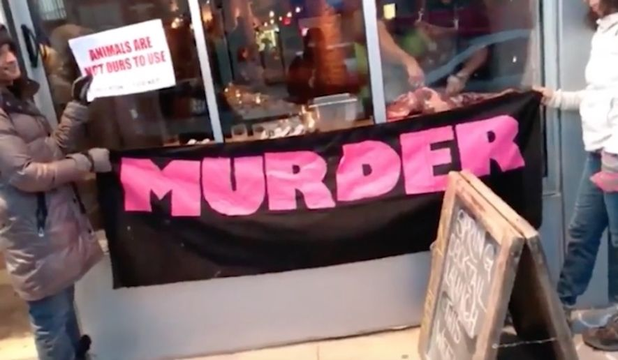 Michael Hunter, owner of the Antler Kitchen & Bar in Toronto, has seen an uptick in business after he butchered a deer leg in front of a group of animal-rights activists who have been protesting his restaurant since December. (Video screenshot via The West Australian)