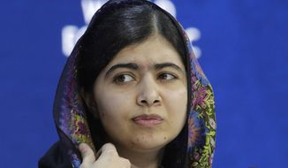 In this Jan. 25, 2018, file photo, Nobel laureate Malala Yousafzai attends an annual meeting of the World Economic Forum in Davos, Switzerland. Malala Yousafzai returns to Pakistan on Thursday, March 29, 2018 for the first time she was shot in 2012 by militants for championing girls' education. (AP Photo/Markus Schreiber, File)