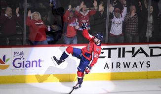 Washington Capitals center Evgeny Kuznetsov, of Russia, celebrates his game-winning goal in overtime of an NHL hockey game against the New York Rangers, Wednesday, March 28, 2018, in Washington. The Capitals won 3-2. (AP Photo/Nick Wass)