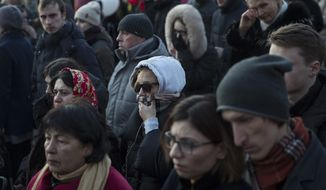 Mourners in Russia brought flowers, toys and candles for the victims of Sunday's fire in a shopping mall in the far-away Siberian city of Kemerovo. (Associated Press)