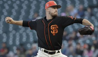 San Francisco Giants pitcher Chris Stratton throws against the Oakland Athletics during the first inning of a spring baseball game in San Francisco, Tuesday, March 27, 2018. (AP Photo/Jeff Chiu)