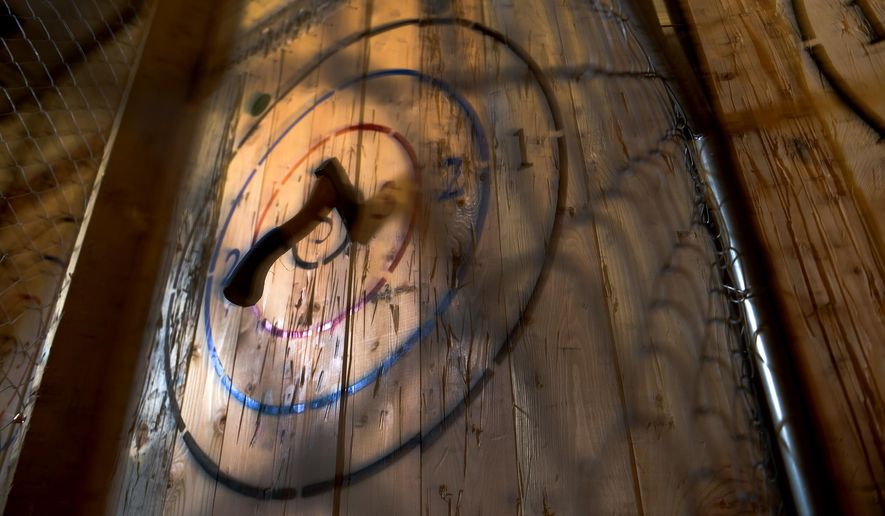 This Feb. 1, 2018, photo, shows an area inside Social Axe Throwing in Ogden, Utah. Ogden's Social Axe Throwing has been in operation since April 2017 and a Salt Lake City location opened in February 2018. The Salt Lake City location has been approved for a license to serve beer. (Leah Hogsten/The Salt Lake Tribune via AP)