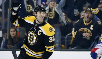 FILE - In this Dec. 16, 2017, file photo, Boston Bruins' Zdeno Chara (33), of Slovakia, celebrates a goal by teammate Danton Heinen against the New York Rangers during the second period of an NHL hockey game in Boston. The Bruins have locked up defenseman Zdeno Chara for another season. The Bruins agreed to pay the 2009 Norris Trophy winner $5 million next year, when he will turn 42, with incentives that could add another $1.75 million. (AP Photo/Michael Dwyer, File)