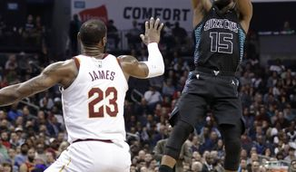 Charlotte Hornets' Kemba Walker (15) shoots over Cleveland Cavaliers' LeBron James (23) during the first half of an NBA basketball game in Charlotte, N.C., Wednesday, March 28, 2018. (AP Photo/Chuck Burton)